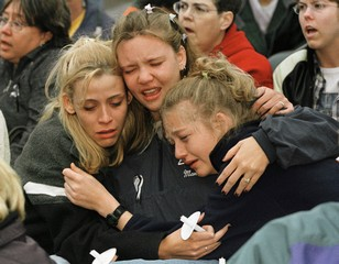 HIGH SCHOOL STUDENTS HUG AND SING AT PRAYER VIGIL IN DENVER